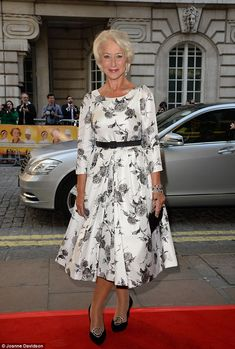 Flower power: Helen Mirren looked lovely as she arrived at the gala screening of The Hundred-Foot Journey at the Curzon in Mayfair, London o...