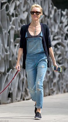 Naomi Watts wears grungy denim dungarees while walking her dog in New York City.