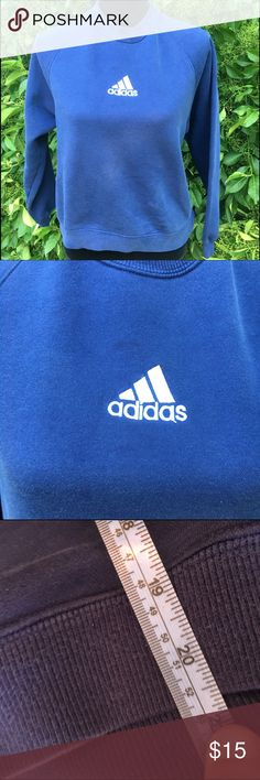 Classic adidas sweatshirt blue white small Classic adidas sweatshirt. It is in worn condition. It has a slight discoloration or stain above the logo. You can barely see it. I try to show it. It is still very cute and retro. Pit to pit 20 and 20 inch length. It is on the short side. Adidas Tops Sweatshirts & Hoodies