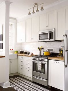This tiny apartment kitchen wasn't functional when the homeowners moved in, but all new IKEA cabinetry gave them plenty of storage without blowing the budget. Clean-lined Shaker-style doors are timeless and coordinate with the building's 90-year-old sensibility.