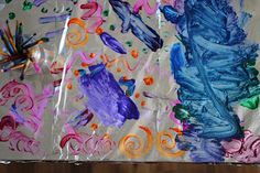 Table Top Tin Foil Painting!  Put a little dish soap in paint - helps with clean up and stains :)
