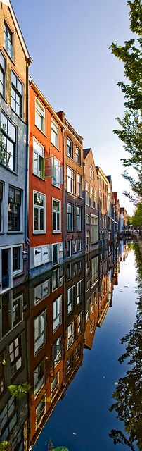 Perfect reflection in canal. Voldersgracht Delft, Holland.