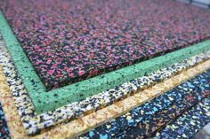 Flecked, coloured, recycled rubber by Mohawk Group at the Surface Design Show 2014