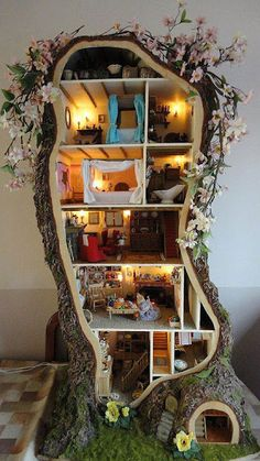 "I love the Brambly Hedge books! Miniature mouse tree house created by a young mother who was inspired by Jill Barklem's Brambly Hedge books. She fashioned it to look like ""Crabapple Cottage"" from Barklem's book, ""Spring Story"". Kids Crafts, Diy And Crafts, Wooden Crafts, Paper Crafts, Brambly Hedge, Miniature Trees, Miniature Gardens, Tiny Dolls, Diy Dollhouse"