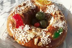 """This Christmas bread, also known as """"three kings bread"""" is wreath shaped and has a babay Jesus doll baked inside."""