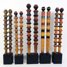 Great ready made sculptures!   5 pairs of antique turned wooden croquet posts with original paint.