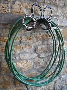 Hose holder from horseshoes.