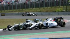 Lewis Hamilton (GBR) Mercedes AMG F1 W06 battles with Valtteri Bottas (FIN) Williams FW37 at Formula One World Championship, Rd10, Hungarian Grand Prix, Race, Hungaroring, Hungary, Sunday 26 July 2015. © Sutton Motorsport Images