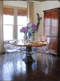 wood table with ghost chairs