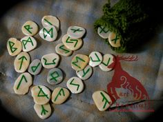 This is a 24-piece painted rune set made of shell fragments. Runes come with a green knit-bag. May be purchased at http://harthandicraft.storenvy.com/products/3436865-green-rune-set #pagan #rune #runeset #harthandicraft