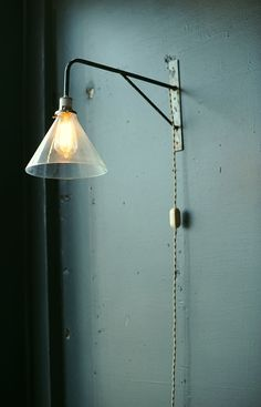 Industrial wall light with deep cone shade