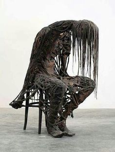 This is amazing... Dress a skeleton in ragged clothing and boots, coat mop heads in monster mud and drape allover.