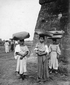 Filipino women with baskets on their heads, Philippines, early 20th Century by John T Pilot, via Flickr