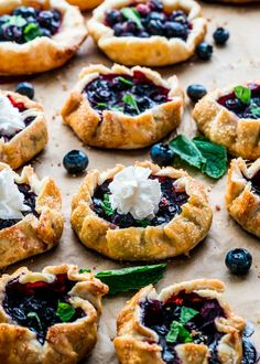 These Mini Blueberry Galettes are perfect for a quick dessert. They& perfectly crisp, flaky, delicious and so impressive. The ultimate summer dessert! Mini Desserts, Blueberry Desserts, Easy Desserts, Mini Blueberry Pies, Dessert Simple, Quick Dessert, Tart Recipes, Sweet Recipes, Cooking Recipes