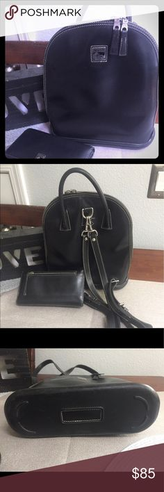Back pack style purse and wallet Dooney back pack style purse and wallet. Wear shown in pics a good leather cleaning could make it look new! Zipper on wallet missing piece shown in pic. Good condition even with wear. Dooney & Bourke Bags Backpacks