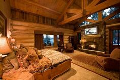 ceiling beams and fireplace in bedroom