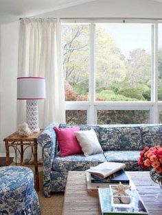 Neo-Pastoral Living Room - the cushy sofa is a chic and cost-effective investment...picking up pale blue accents and decorative animal pieces. Pink detailing like the Pier 1 throw pillows shown lend some punchy character...