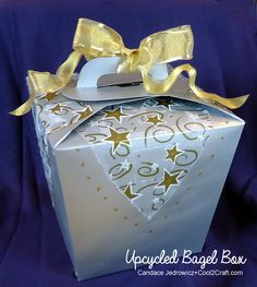 Candace Jedrowicz transforms a large bagel box into a gift box! Featured on www.cool2craft.com