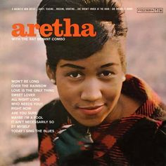 A young Aretha Franklin wearing a lovely French Roll updo w/sideswept bangs (1960s)