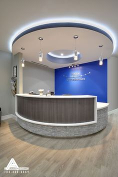 Blue and Stone Modern Reception Desk. Dental Office Design by Arminco Inc.: