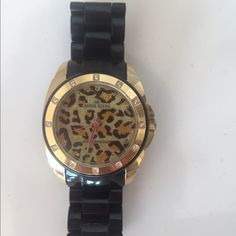 Anne Klein Watch Leopard face. A few scratches on the bracelet of the watch. Nothing noticeable. Worn a few times. Needs new battery. Beautiful piece. Anne Klein Jewelry