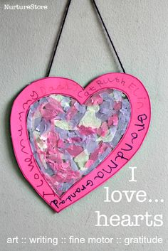 Gorgeous easy Valentine craft for kids - contact paper hearts with a focus on fine motor skills and gratitude