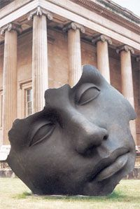 In the garden of the British Museum, a sculpture of a face rests on the lawn like a giant tumbled from the sky. We are giants.