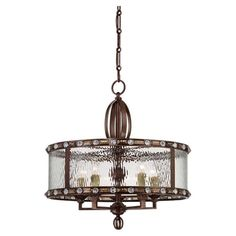 Pairing a gilded bronze finish with crystal accents and a watered glass shade, this timeless pendant casts a warm glow in your foyer or dining room.