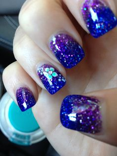 Purple and blue ombre acrylic nails.