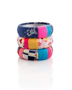 Wrap ribbon, string & fabric around dollar store bracelets. Secure with hot glue.