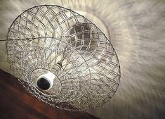 20 upcycle design chandelier ideas compiled by upcycleDZINE. All the designs are made of discarded or vintage materials or objects.