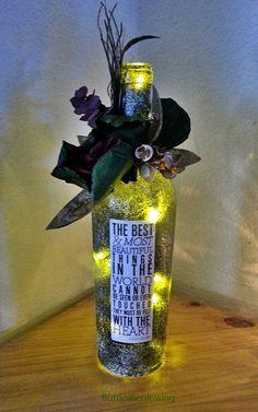 Bottle lights clovers and bottle on pinterest for Most beautiful wine bottles