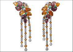 Étourdissant Cartier, orecchini in platino con granati color mandarino e melanzana incisi, perline di granati, zaffiri colorati e tsavoriti e diamanti taglio brillante