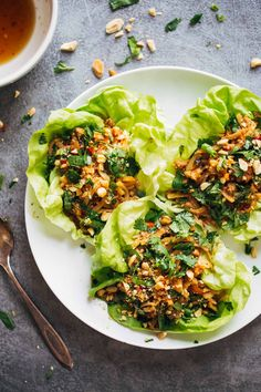 Peanut Chicken Lettuce Wraps with Garlic Ginger Sauce from PinchOfYum.com