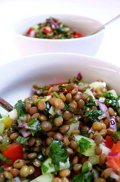 Lentil Salad 2 C lentils 2 cucumbers peeled/diced 1 red pepper,diced 1/2C parsley, chopped 1 red onion diced 1 cl garlic chopped  olive oil, apple vinegar salt white pepper chilli powder