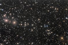14 Of The Year's Most Amazing Space Photos:  Bob Franke/Flickr-The Perseus galaxy cluster - Abell 426 is about 250 million light-years from our galaxy and contains more that 500 catalogued galaxies. The brightest member is NGC 1275, near the left edge of the image, at magnitude 11.6. NGC 1275 is a strong source of radio waves and x-rays.