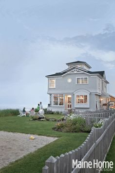 A summer cottage on Higgins Beach is reborn into a contemporary captain's house.