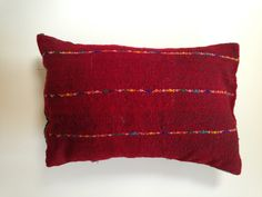Diamond Embroidered Double Sided Cushion  This unique cushion injects a burst of colour to your space. With it's intricate geometric embroidery on one face and a simple, bright red with multi-coloured stripes on the backing, this cushion can change to suit your mood.  35 x 50cm Geometric Embroidery, Embroidered Cushions, Suits You, Stripes, Bright, Change, Throw Pillows, Mood, Colour