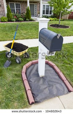 Laying Mulch Around The Mailbox And Placing Edger Bricks. Stock … Laying Mulch Around The Mailbox And Placing Edger Bricks. Mailbox Garden, Mailbox Landscaping, Outdoor Landscaping, Lawn And Garden, Outdoor Gardens, Landscaping Ideas, Mailbox Plants, Mulch Ideas, Landscaping With Rocks