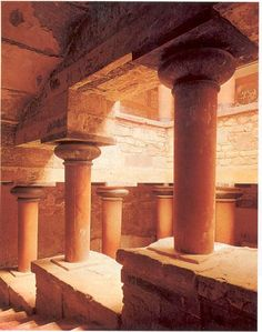 Court with staircase reconstructed by Sir Arthur Evans: Leading to the southeast residential quarter, palace complex, Knossos, Crete.  Hall is supported by uniquely Minoan-type wood columns that became standard in Aegean palace architecture. The top of the columns that supported the massive roof beams and a broad flattened capital was wider that the bottom. Was arranged around a central space (rather that along a long axis)