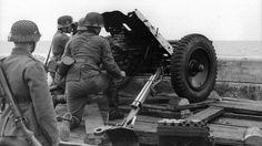 m4a1-shermayne:  German soldiers using aPanzerAbwehrKanone (PAK) 36 in Denmark, 1940.
