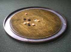 Beautiful Crokinole board by the Hilinskis.