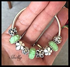 A new Pandora bracelet in the works. I love the green looking glass muranos with the Daisy clips.