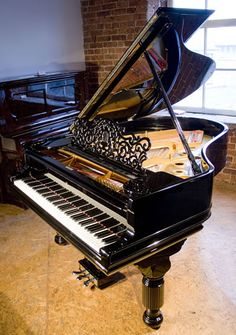 An 1893, Steinway Model A grand piano with a black and elephant legs at Besbrode Pianos         https://bobbysmith.bandpage.com/