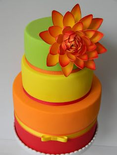 bright and fun cake ... green, yellow, orange, red with lotus flower