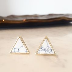 "Triangle marble earrings Do not buy this listing! ⚠️ comment and I'll make a listing for you.                                                    Chic and minimal polished howlite triangle earrings .5"" diameter. Each pair is unique and the veins vary slightly. No trades. No offers, price is firm. Ladyluxe clothing Jewelry Earrings"