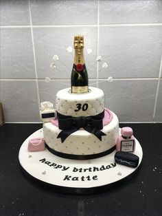 Classy 2 tier for a 30th with champagne bottle. X