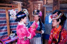 Mosuo girls prepare for the Fire Dance