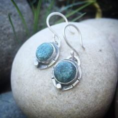 Turquoise Drop Earrings, Sterling Silver  This pair of striking teal turquoise stones, with black webbing, are accentuated by one hammered sterling silver bead and oxidized for a perfectly rustic touch. Hanging by a loop and attached to a handmade earring hook, these will hang approximately 1 1/4 inches from your piercing site. Earring details: Size- 1.25 inches with hook Weight- 5 grams Zodiac Birthstone: Sagittarius (22 Nov - 21 Dec) Chakra Associations: Throat Energies: Traveling…