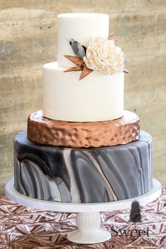 Modern, industrial marble and hammered copper wedding cake by Sweet By Design in Melissa, TX.